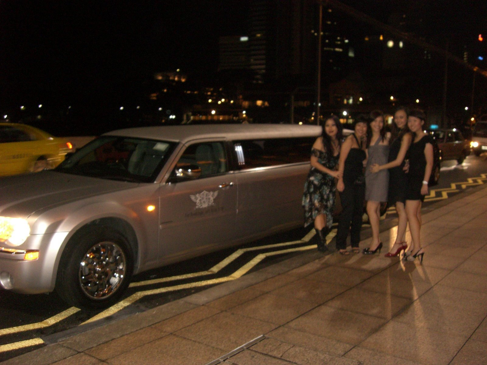 Our stretch limo... yours truly in the scrappy red heels!